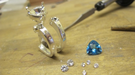 Dan Balk Jewelry Ring with diamonds and a triangle blue topaz, hand fabrication from raw materials process picture