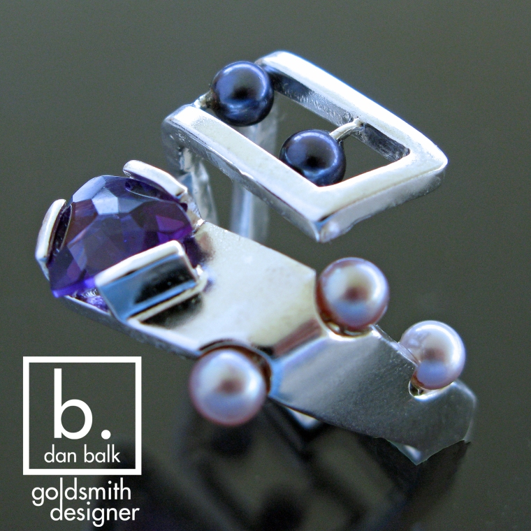 Dan Balk Jewelry Silver Ring with a triangle amethyst and pearls.